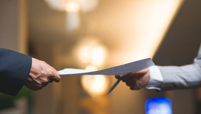 Hands of business people passing important document
