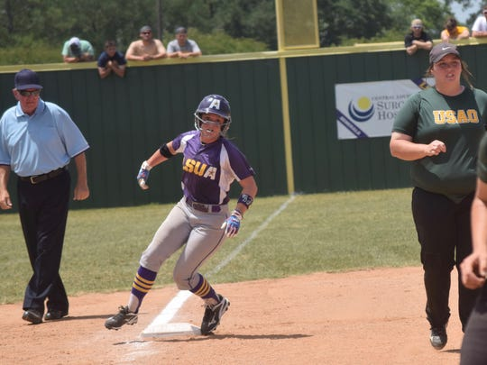 LSUA's Kimber Gruehl (11) lands on third against the University of Science & Arts of Oklahoma Wednesday in the NAIA Softball Championship opening round.