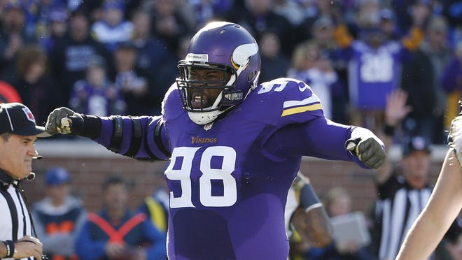 Minnesota Vikings defensive tackle Linval Joseph (98) reacts after a play during the first half of an NFL football game against the St. Louis Rams on Sunday.