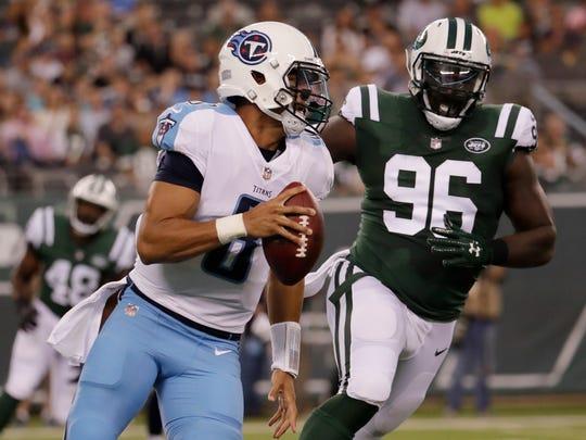 Tennessee Titans quarterback Marcus Mariota (8) runs