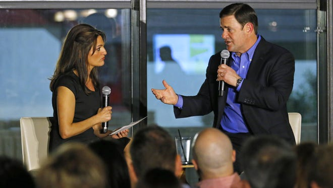 Gov. Doug Ducey takes part in a Q & A with Republic political reporter Yvonne Wingett Sanchez at Mod Coworking on Jan. 6, 2016 in Phoenix.