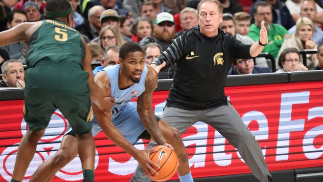 Michigan State head coach Tom Izzo directs as his team plays defense against the North Carolina during the first half Sunday night in Portland, Oregon.