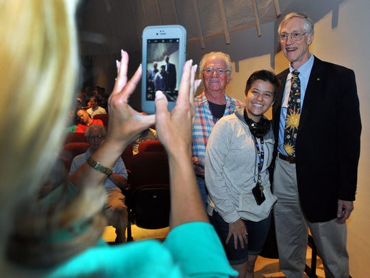 Bob Brown of Melbourne and Maria Galuez of Mexico City a FIT student gets a photo taken with Dr. John C. Mather, a JWST Senior Project Scientist at Goddard Space Flight Center and also shared the 2006 Nobel Prize for Physics before his lecture Thursday night at the Florida Tech's W. Lansing Gleason Performing Arts Center on his latest project the James Webb Space Telescope, in front of a packed house.
