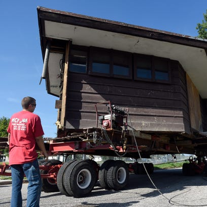 Alex Deffendoll of MCF House Movers watches as the