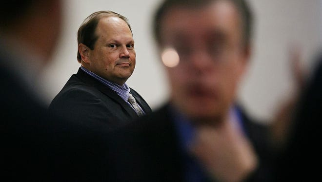 Eddie Tipton looks over at his lawyers before the start of Wednesday's proceedings at the Polk County Courthouse in Des Moines.