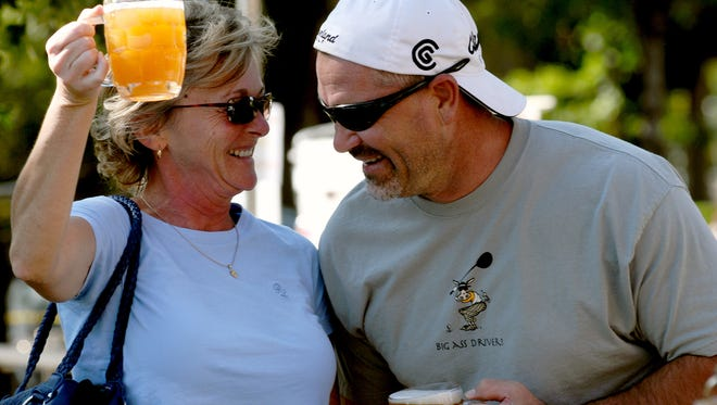 Rochelle Tenaro and Vern Woolen join in a German toast at a past Oktoberfest celebration.