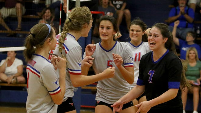 The Graham Lady Blues celebrate winning a point off of Monterey in the Division I Gold Bracket Championship match Saturday, Aug. 19, 2017, at the Lu Allen Memorial Volleyball Tournament in Graham. The Lady Blues defeated Monterey 25-15, 25-23.