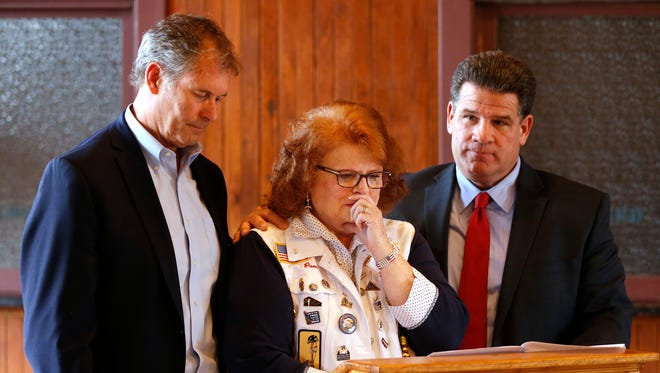 """Flanked by mayors John Dennis, left, of West Lafayette, and Tony Roswarski of Lafayette, Gold Star Mother Pam Mow becomes emotional as she announces Tuesday, March 6, 2018, that the Honor Flight will come to a end after the final flight in 2018. """"It's just time to end this noble effort,"""" said Mow. A total of four Honor Flights will take place in 2018. Mow's son, Cody Putnam, died in 2007 in Iraq."""