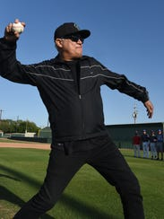 Rev. Denny Duron throws out the first pitch before