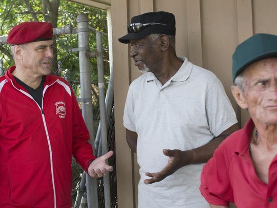 Curtis Sliwa, founder of Guardian Angels, speaks with a Wilmington resident at the Adams 4 Shopping Center in Wilmington Sunday. Guardian Angels, a non-profit, is recruiting members for a Wilmington Chapter.