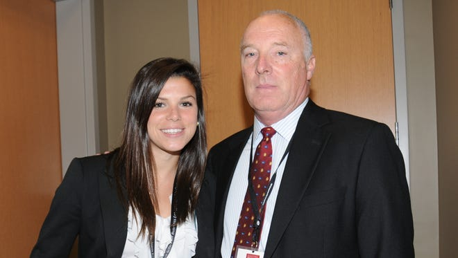 Jenna DeLetto holds the prototype 5 POP, with William Burke, SU director of entrepreneurship competitions.