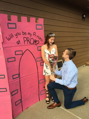 Blake Chesley, 18, asks his girlfriend Bella Jensen, 18, to the Roosevelt High School prom.