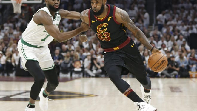 The Cavaliers' LeBron James drives past the Celtics' Jaylen Brown during Game 6 of their Eastern Conference Finals in May 2018 in Cleveland. After the Celtics had achieved a 3-2 lead in the series, the Cavs took the last two games to move on to the NBA Finals.