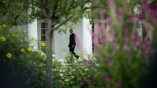 President Obama walks back to the West Wing of the White House  this week.