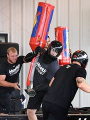 Former Clemson lineman Landon Walker, who is the gas man for NASCAR Sprint Cup series drive Kasey Kahne, practices with the crew at Hendrick Motor Sports this summer.