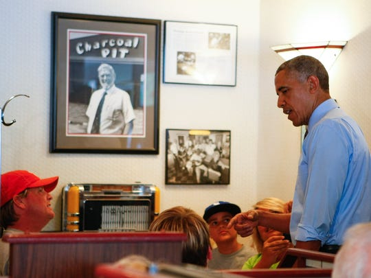 Former President Barack Obama at the Charcoal Pit on Concord Pike in 2014.