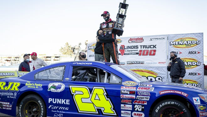 Ryan Unzicker gets a hug from his son, Brody, 7, as he celebrates winning the ARCA Racing Series Allen Crowe 100 on the Springfield Mile at the Illinois State Fairgrounds, Sunday.