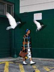 """Photographer Daniel Arnold, a Milwaukee native, calls himself """"a paparazzo for strangers."""" His fashion-centered images of walking New Yorkers are on display at the Museum of Wisconsin Art in West Bend."""