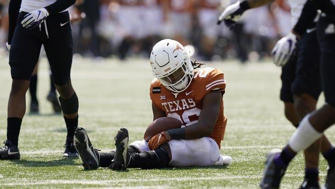 Texas running back Keaontay Ingram (26) reacts after he was stopped short of a touchdown on a run against TCU during the second half Saturday in Austin, Texas.