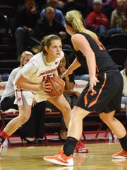 Marist College's Kendall Baab looks to make a move against a Princeton defender on Dec. 29, 2015 at McCann Arena.