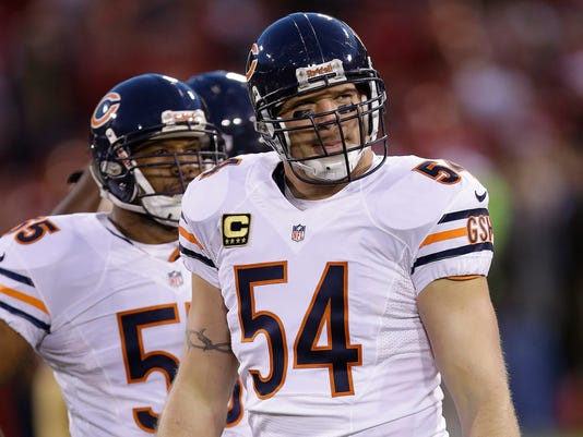 FILE - In this Monday, Nov. 19, 2012 file photo, Chicago Bears middle linebacker Brian Urlacher (54) and outside linebacker Lance Briggs (55) warm up before an NFL football game against the San Francisco 49ers in San Francisco. Star linebackers Ray Lewis and Brian Urlacher and game-breaking wide receiver Randy Moss are among 11 first-year eligible players for the Pro Football Hall of Fame.  (AP Photo/Marcio Jose Sanchez)