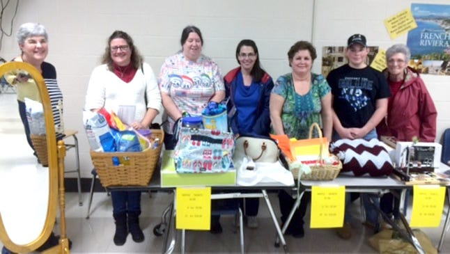 Raffle winners display their prizes, following the South Eastern Dollars for Scholars Bingo on March 19. They are pictured from left: Kathy Heaps won the cheval mirror donated by Hostler's Furniture; Lisa Kincaid won the laundry basket including a $150 Best Buy gift card sponsored by Ben and Cindy Hushon and EI Associates; Kathy Tarbert won the 31 Bags utility tote sponsored by Apple Ford of Red Lion; Leanne Miller won the Dooney & Bourke zip satchel sponsored by South Eastern Dollars for Scholars Board Members; Deb Thompson won the carpeting donated by Floors 4 U 2 of Stewartstown; Braden Zimmerman won the ripple Afghan made and donated by Patti Gibney; Betty Keesee won the fly tying kit donated by Bass Pro of Harrisburg.
