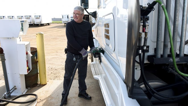 Darrell Damm refuels a truck at K&J Trucking Inc. on Tuesday. This week is National Truck Driver's Appreciation Week.