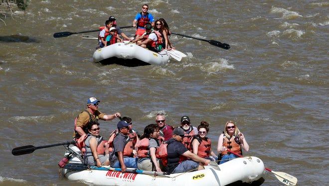 Visitors to Riverfest head down the Animas River on May 28, 2016, near Berg Park in Farmington.