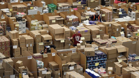 Parcels are processed and prepared for dispatch at an Amazon fulfillment center.