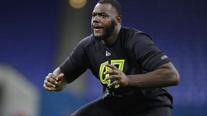 Georgia offensive lineman Andrew Thomas runs a drill at the NFL Combine in Indianapolis on Feb. 28.