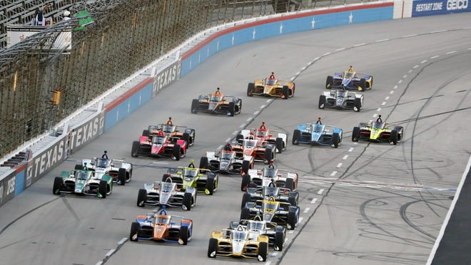 The field gets a green flag for the start of an IndyCar auto race at Texas Motor Speedway in Fort Worth, Texas, Saturday, June 6.