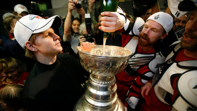 Chris Osgood gets ready to drink from the Cup in 2008.
