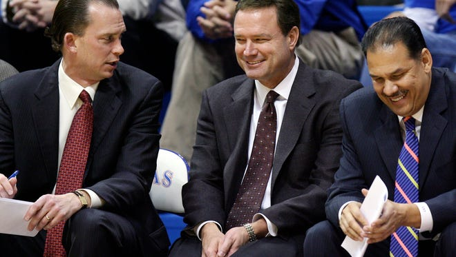 FGCU coach Joe Dooley (left) with Kansas coach Bill Self (center) and Jayhawks assistant Kurtis Townsend during Dooley's KU tenure.