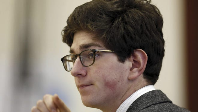 Owen Labrie listens to testimony in Merrimack County Superior Court in Concord, New Hampshire, during his trial.