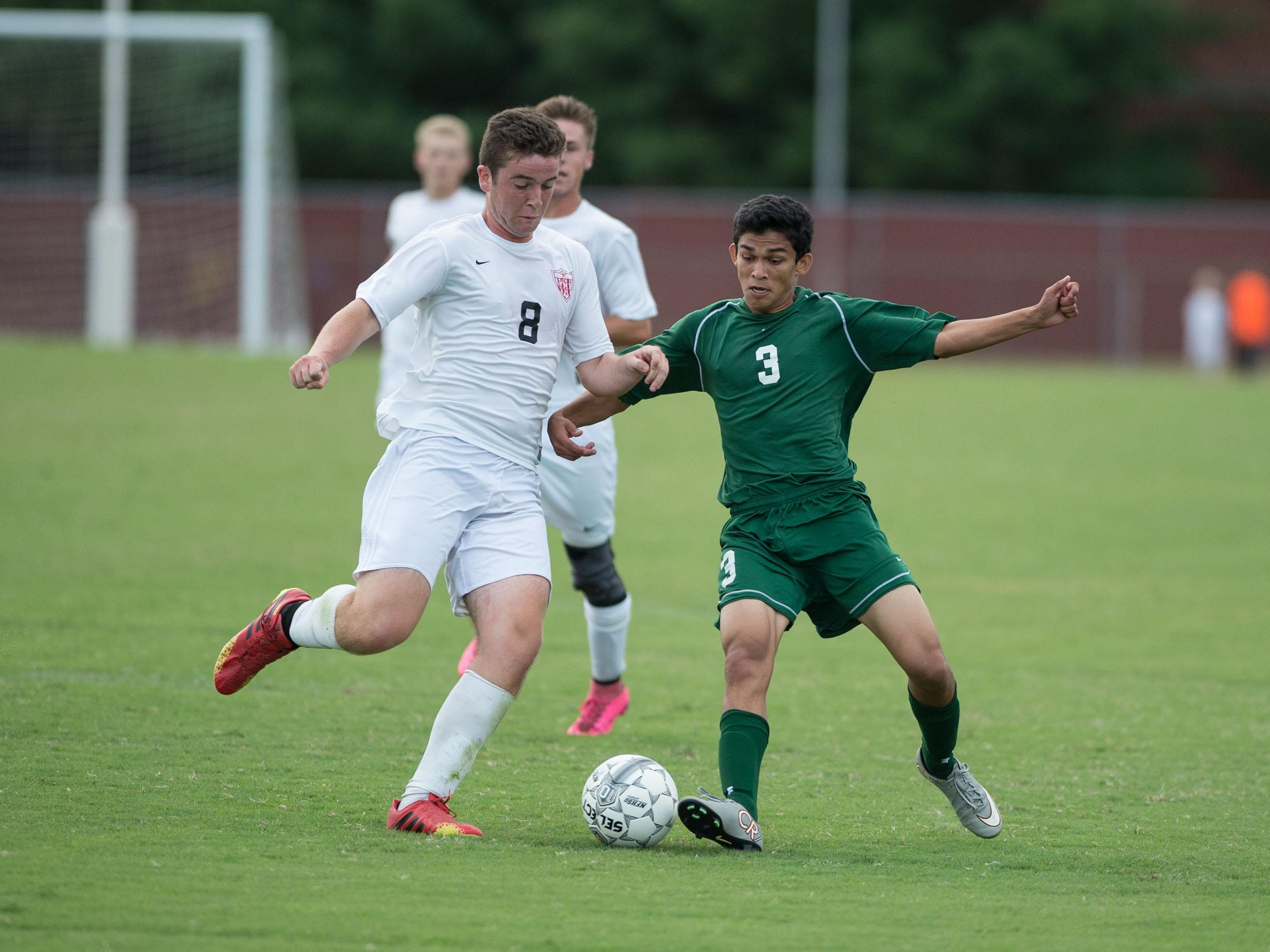 Parkside's Ramit Gupta, right, attempts to steal the ball from JMB's Stefan Swierkosz.