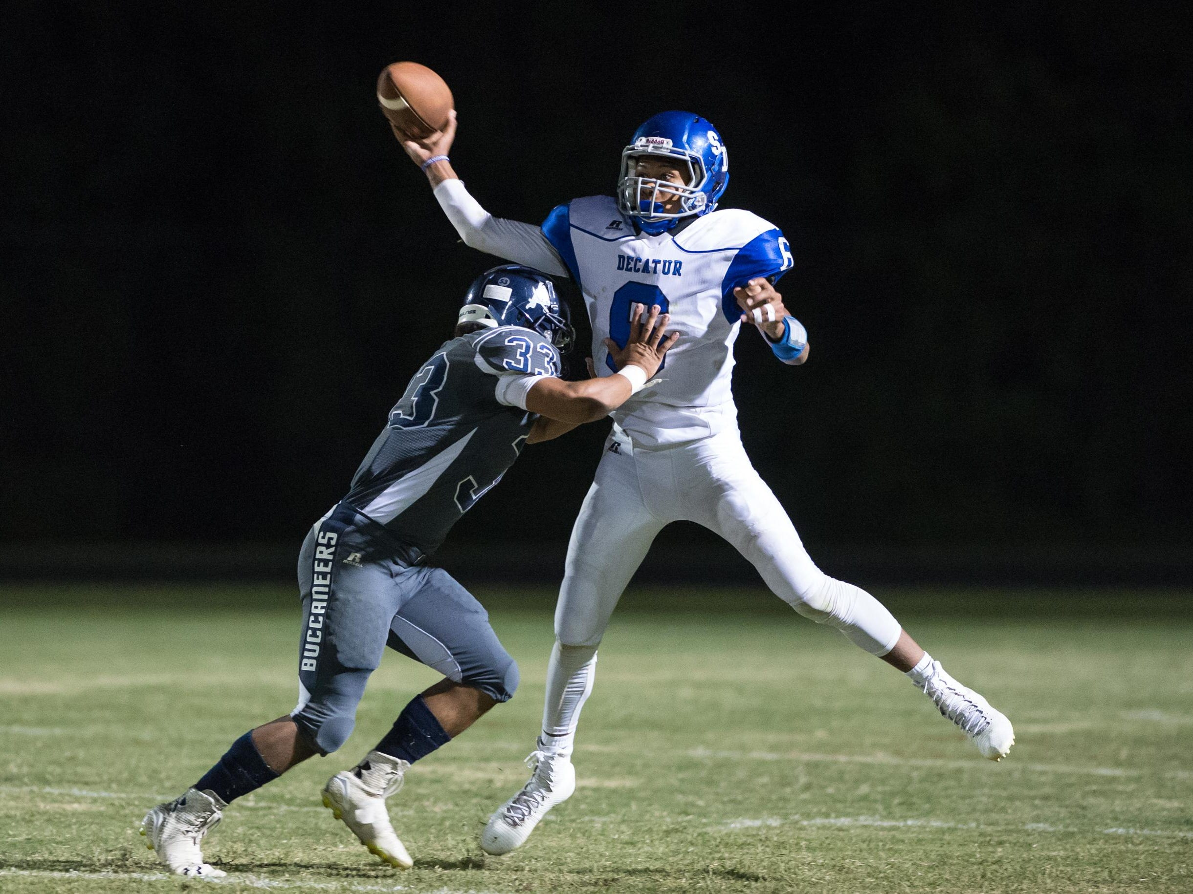Stephen Decatur quarterback Darion McKenzie throws a pass as Kent Island's DJ Galloway attempts to make a sack.