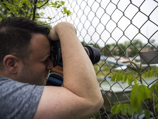 Local photographer Jason Gambone photographs a boat yard along the Cooper River Wednesday, May 11 as part of the #SJShowUs art exhibit co-sponsored by the Courier-Post and Visit South Jersey.