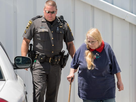Susan Murphy of Eden, Md., is escorted by the Wicomico County officer on Monday, July 11, 2016.