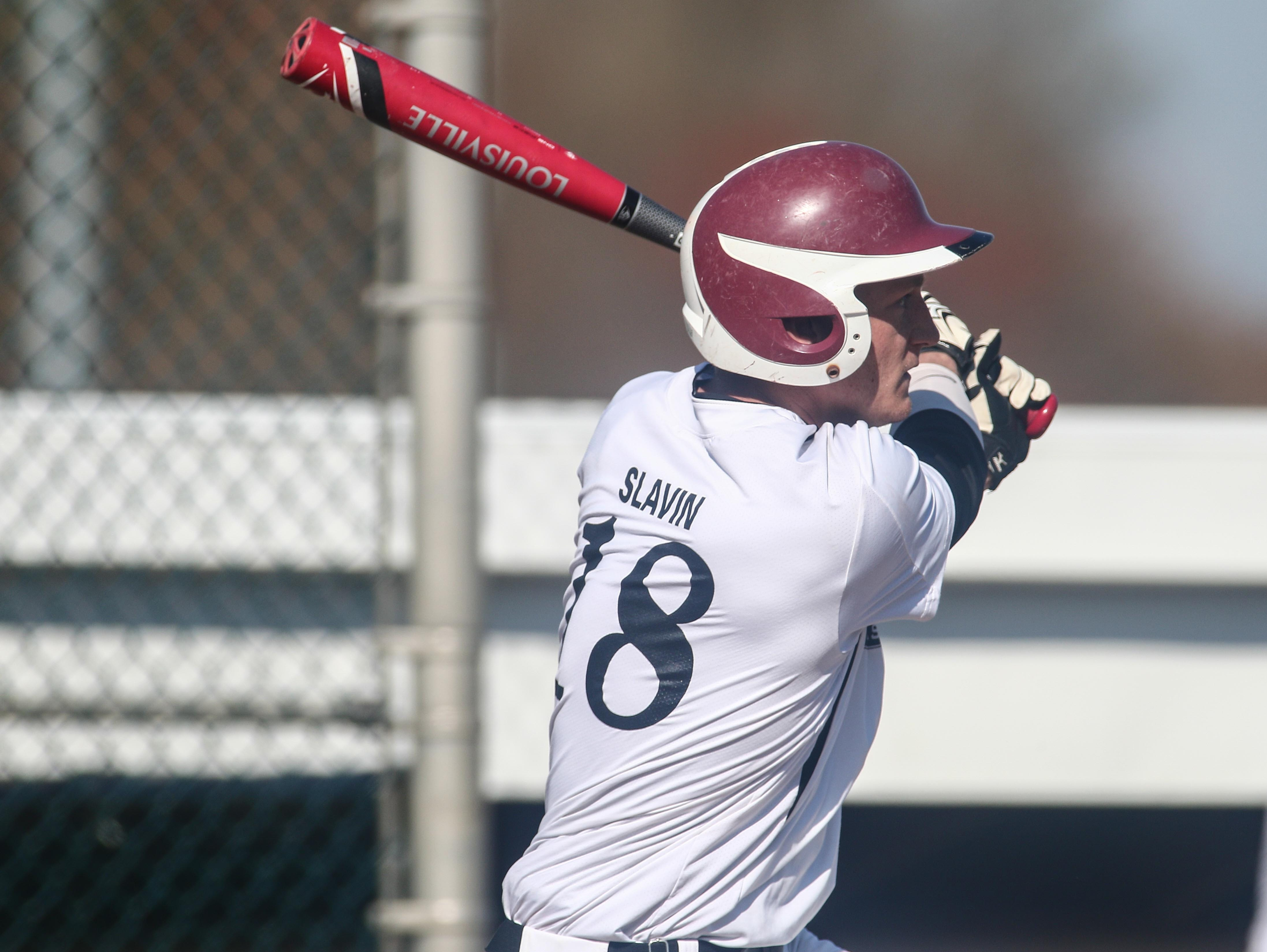 Caravel's Tyler Slavin (18) played a part in the Buccaneers' 10-9 extra inning victory over Conrad on Thursday night.