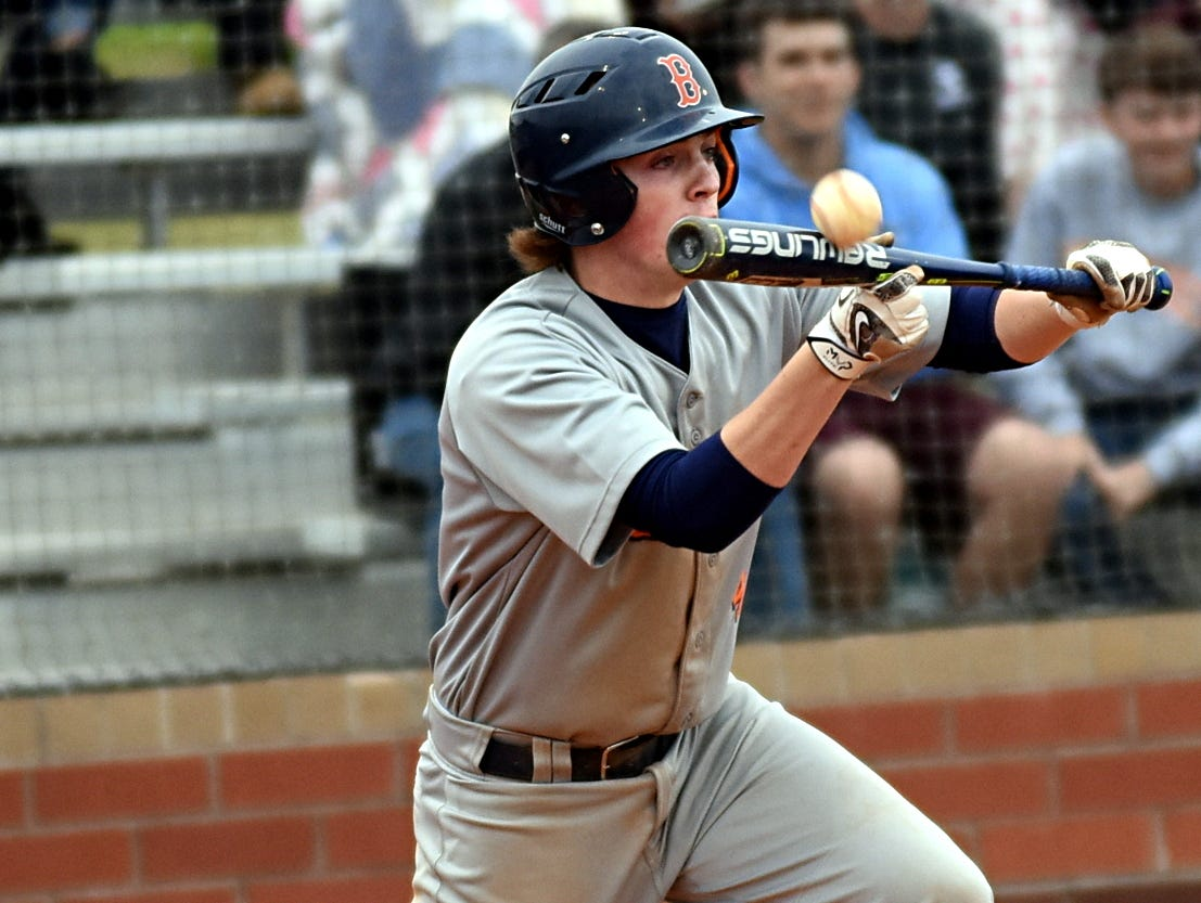 Beech High junior Michael Hayes attempts to lay down a seventh-inning bunt.