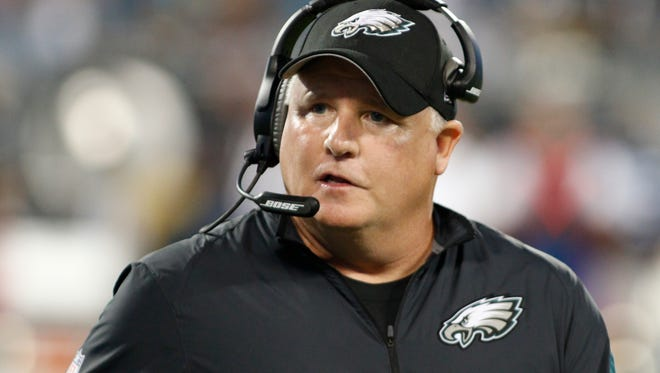 FILE - In this Oct. 25, 2015, file photo, Philadelphia Eagles head coach Chip Kelly watches the action from the sidelines in the first half of an NFL football game against the Carolina Panthers in Charlotte, N.C. The San Francisco 49ers have hired Chip Kelly as their new head coach. CEO Jed York announced the move on Twitter and so did the team. (AP Photo/Bob Leverone, File)
