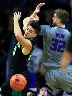 Baylor guard Manu Lecomte (20) knocks the ball loose from Kansas State forward Dean Wade (32) during the first half of an NCAA college basketball game in Manhattan, Kan.