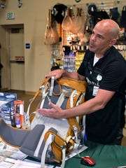 Michael Grimm, with Sierra Trading Post, talks about what to look for in hiking backpack at Sierra Trading Post in Reno on May 4, 2015.