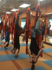 A trapeze yoga class at Bikram Yoga Plus in Palm Desert.