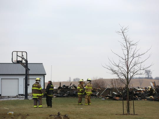 Firefighters respond to a house fire in rural North