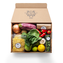 A box of Blue Apron ingredients, including noodles, an eggplant, an onion, and a lemon