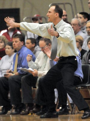 Greensburg High School head coach Stacy Meyer gives instruction from the sideline during the Indiana High School Athletic Association's Class 3A regional boys basketball game against Mt. Vernon on March 13, 2010, at Shelbyville High School.