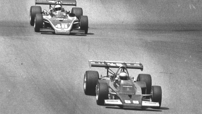 Mark Donohue races to the finish line with Jerry Grant trailing in a last lap duel.