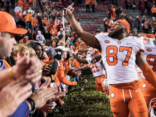 Clemson tight end D.J. Greenlee (87) celebrates in front of fans after an NCAA college football game against South Carolina on Saturday, Nov. 25, 2017, in Columbia, S.C. Clemson defeated South Carolina 34-10. (AP Photo/Sean Rayford)