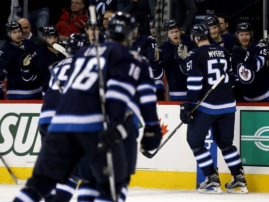 The Winnipeg Jets bench celebrates after Tyler Myers (57) scored against the New York Rangers during the second period of an NHL hockey game Friday, Dec. 18, 2015, in Winnipeg, Manitoba. (Trevor Hagan/The Canadian Press via AP)